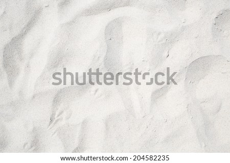 Sand on the the beach as background - stock photo