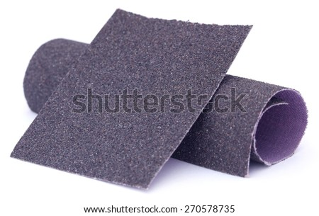 Sand paper roll and sheet over white background  - stock photo