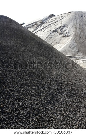 sand quarry mounds of varied construction sands color - stock photo