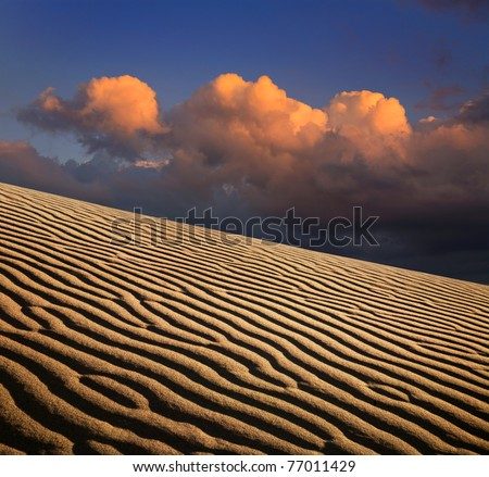 Sand Ripples And A Stormy Cloudscape At Evening Time, Death Valley National Park, California - stock photo