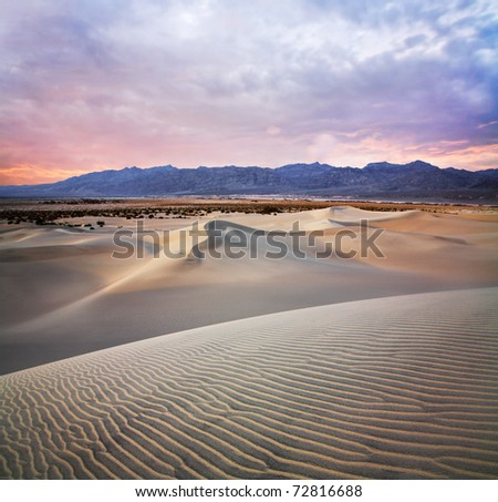 Sand Ripples, Dunes And Mountains At Sunset, Death Valley National Park, California, USA - stock photo