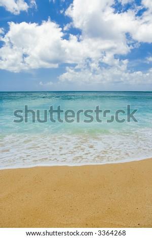 sand, sea, and sky on a beautiful hawaii beach - stock photo