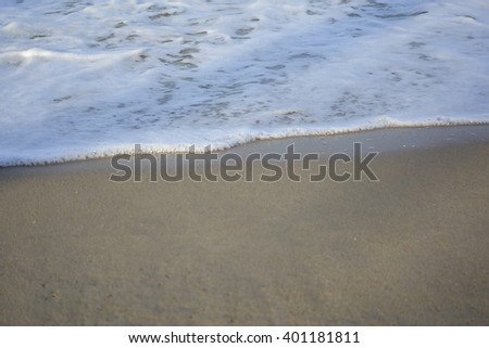 Sand,sea water and beach with lighting in the morning:Close up,select focus with shallow depth of field:ideal use for background.