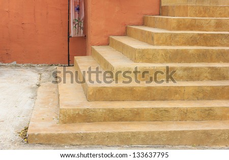 Sand stair steps in front of the building - stock photo
