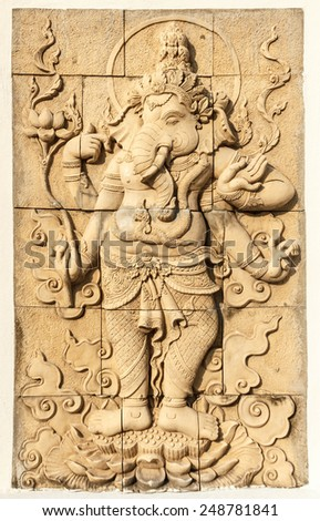 Sand stone Ganesha sculpture on wall. - stock photo