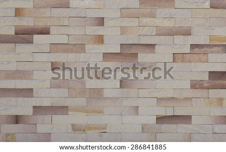 sand stone wall texture and background of decorate - stock photo