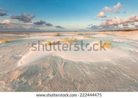 Sand structures on beach under blue sky