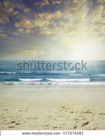 Sand, surf and sun beach scenery - stock photo