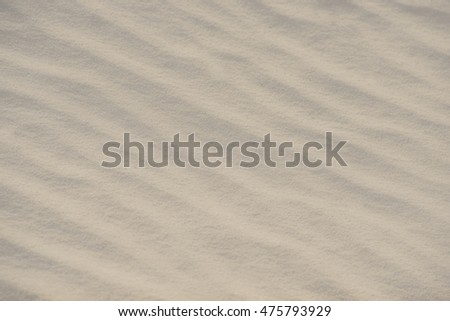 sand surface, blurred background with a light tone