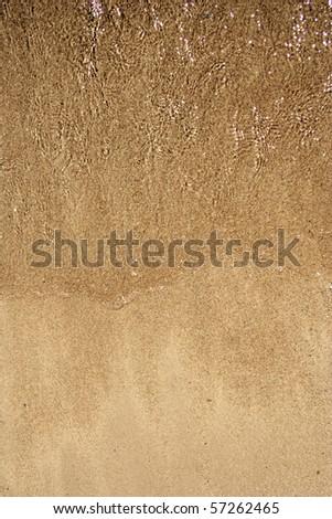 Sand texture on a beach - stock photo