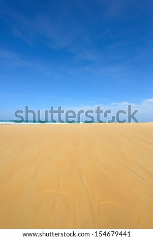 Sand texture with blue sky - stock photo