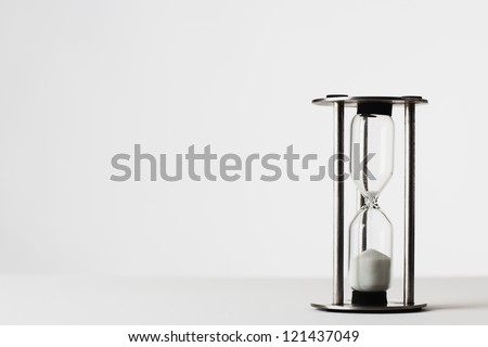 sand timer shot on white background in the studio