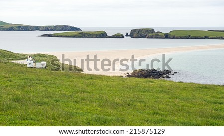 Sand tombolo (causeway) to St. Ninian's Isle on the southwest coast of the main Shetland island, which is located to the northeast of Scotland, United Kingdom - stock photo