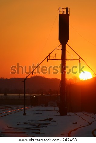 Sand tower at sunset. - stock photo