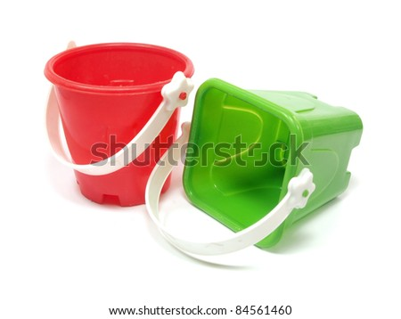 sand toy on a white background - stock photo