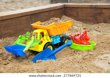 Sand toys in a sandbox / Sand toys - stock photo