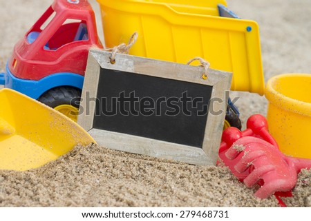 Sand toys in a sandbox with empty plate / sand toys - stock photo