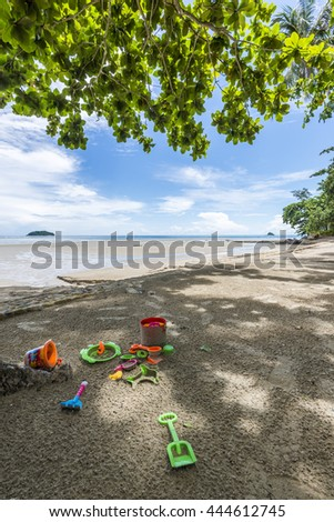 Sand toys on a beach - stock photo