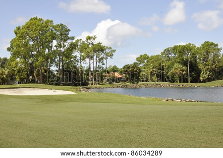 Sand trap and water hazard for a golf course in Naples Florida - stock photo