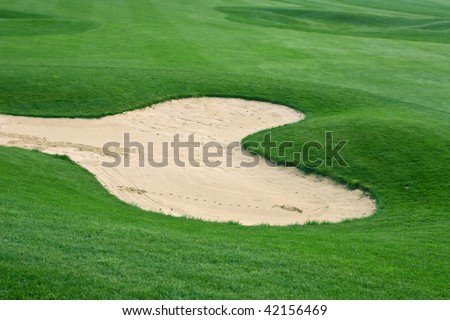 Sand trap on the golf course - stock photo
