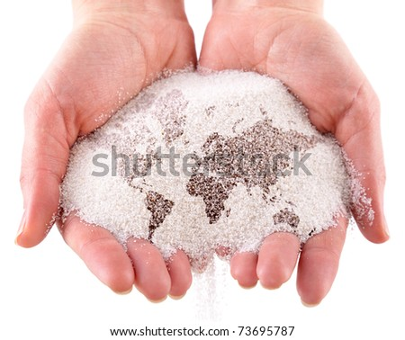 Sand with map of the world in the hands. Isolated on a white background - stock photo