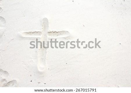 sand Write a cross - stock photo