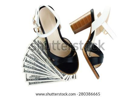 Sandals and money near isolation - stock photo