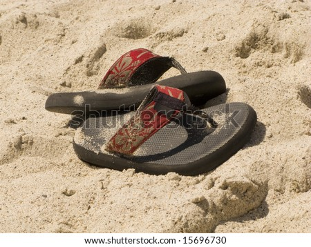 Sandals in the Sand on a San Clemente Beach - stock photo