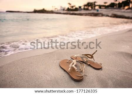 Sandals on a beach - stock photo