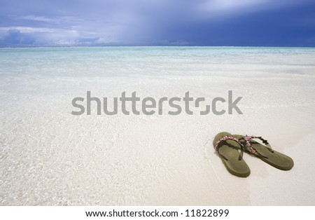 Sandals on the beach, Maldives - stock photo