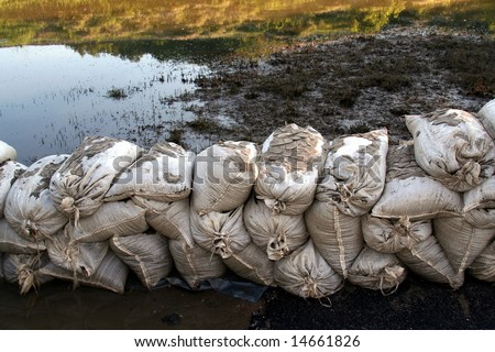 Sandbags still stand in a wall as the waters begin to recede. - stock photo