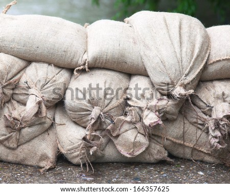 Sandbags to hold back floodwater. - stock photo