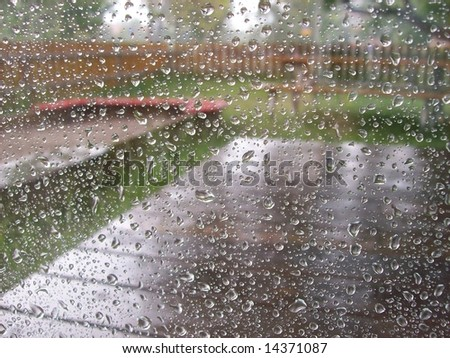 sandbox in the rain - stock photo