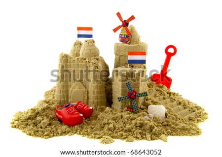 Sandcastle at the Dutch beach isolated over white - stock photo