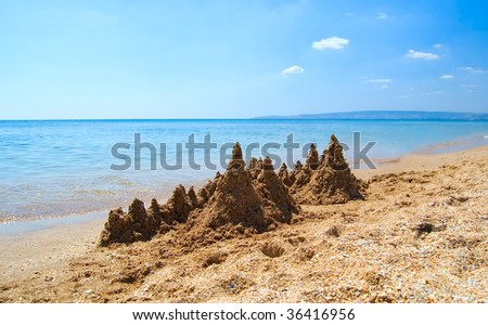 Sandcastle by the sea. - stock photo