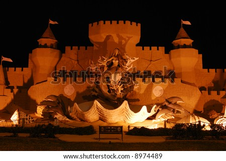 Sandcastle illuminated at night