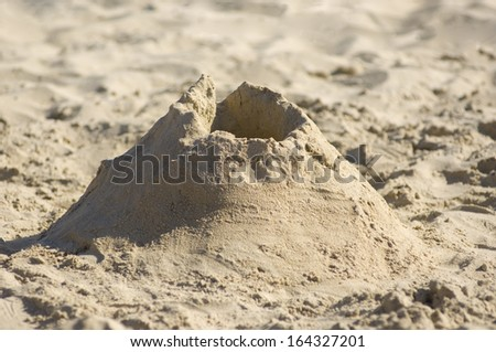 Sandcastle on the beach. Vacation concept and kids staff - stock photo
