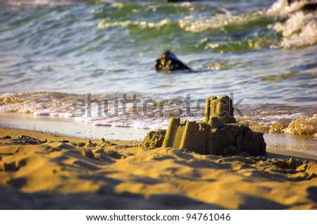 sandcastle ruins in beach - stock photo