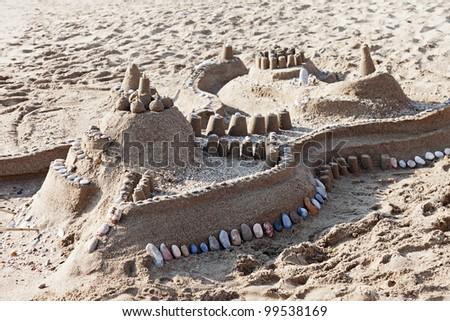 Sandcastle - summer vacations castle on sea sand beach - stock photo