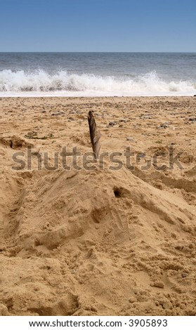 sandcastle waiting for tide - stock photo
