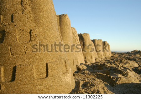 Sandcastles on the beach as metaphor for housing crisis - stock photo