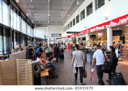 SANDEFJORD, NORWAY - AUGUST 22: Travelers on August 22, 2010 at Sandefjord Airport, Norway. Sandefjord (also known as Torp) is the 7th busiest airport in Norway with 1.6m pax in 2010. - stock photo