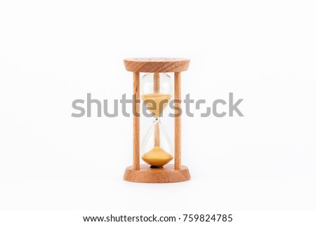 Sandglass, hourglass or egg timer on white table showing the last second or last minute or time out