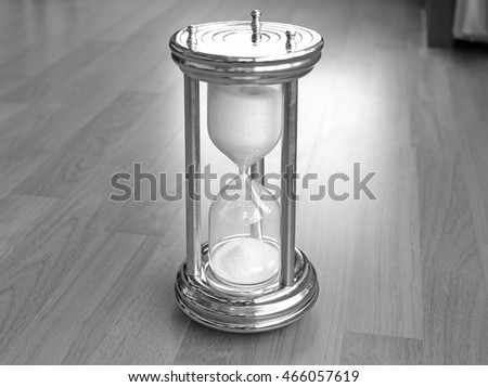 sandglass on wooden background, black and white tone