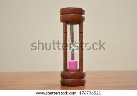 Sandglasss pink sand insite timer - stock photo