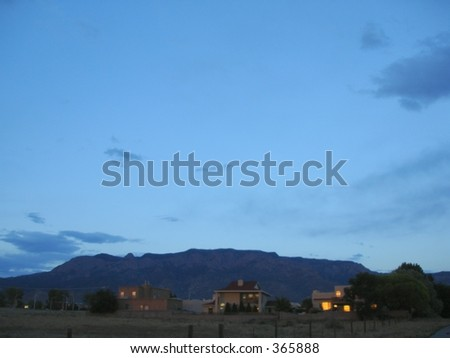 Sandia Mountains and foothills homes during sunset in Albuquerque, New Mexico - stock photo