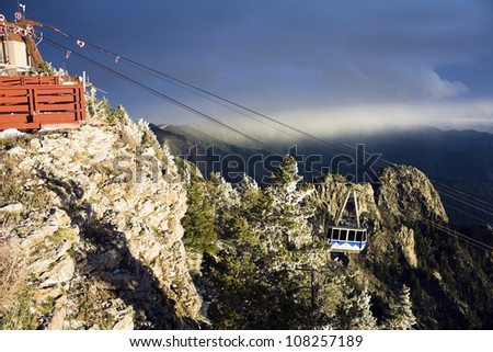 Sandia Mountains Tramway approaching the peak - stock photo