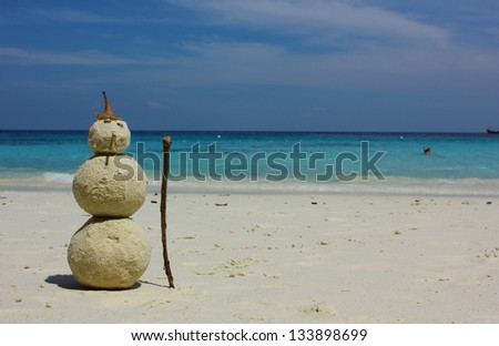Sandman with blue sea background - stock photo