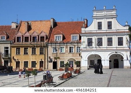 SANDOMIERZ, POLAND - AUGUST 9, 2011: People visit Sandomierz Old Town in Poland. Sandomierz is a historic town established before year 1227. Today it is inhabited by 25,000 people.