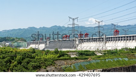 SANDOUPING, CHINA - April 15, 2016: The Three Gorges Dam on Yangtze River has total electric generating capacity of 22,500 megawatts per day, enough to power 22,500,000 North American homes.  - stock photo